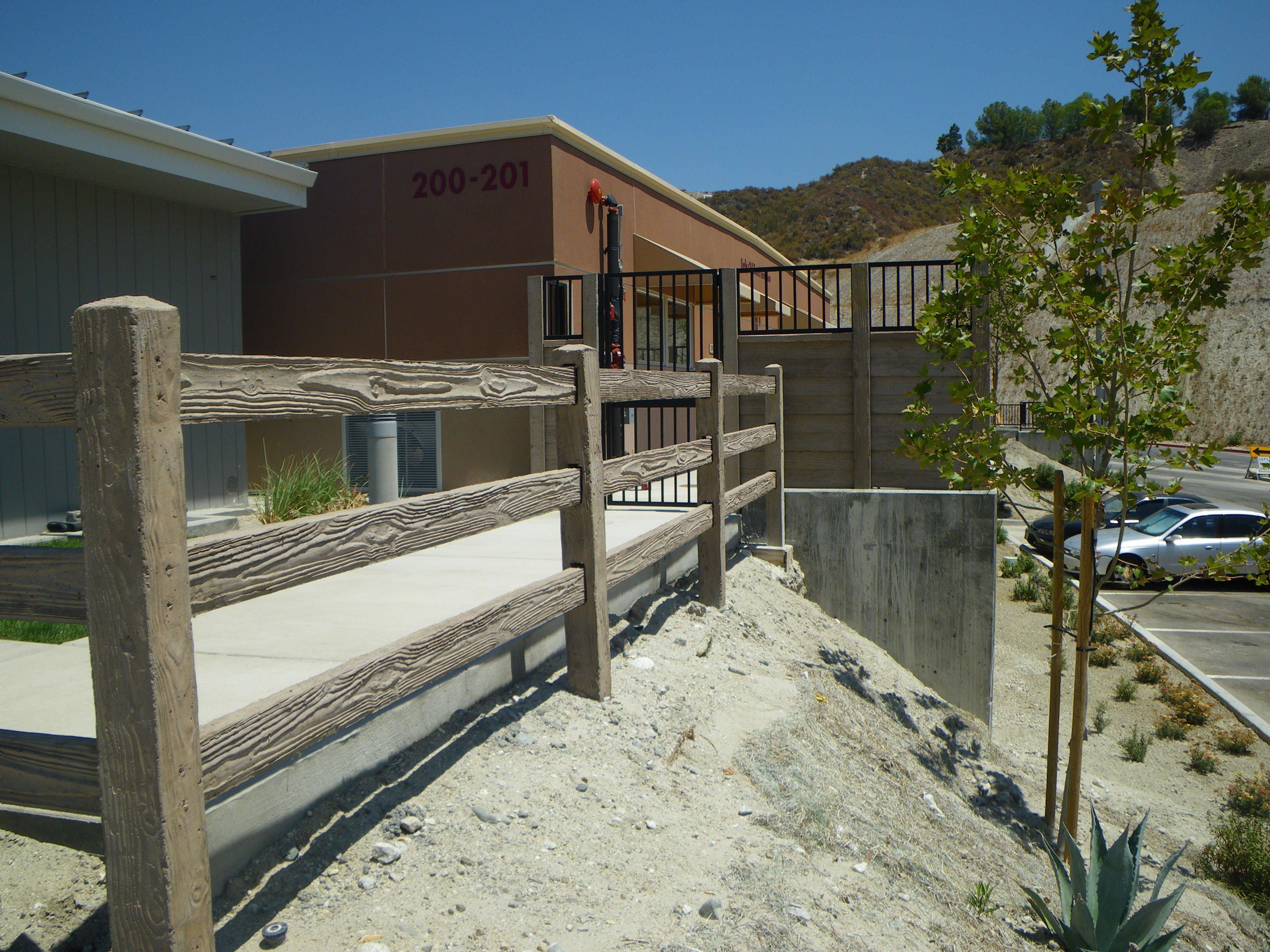 concrete rail fence at school