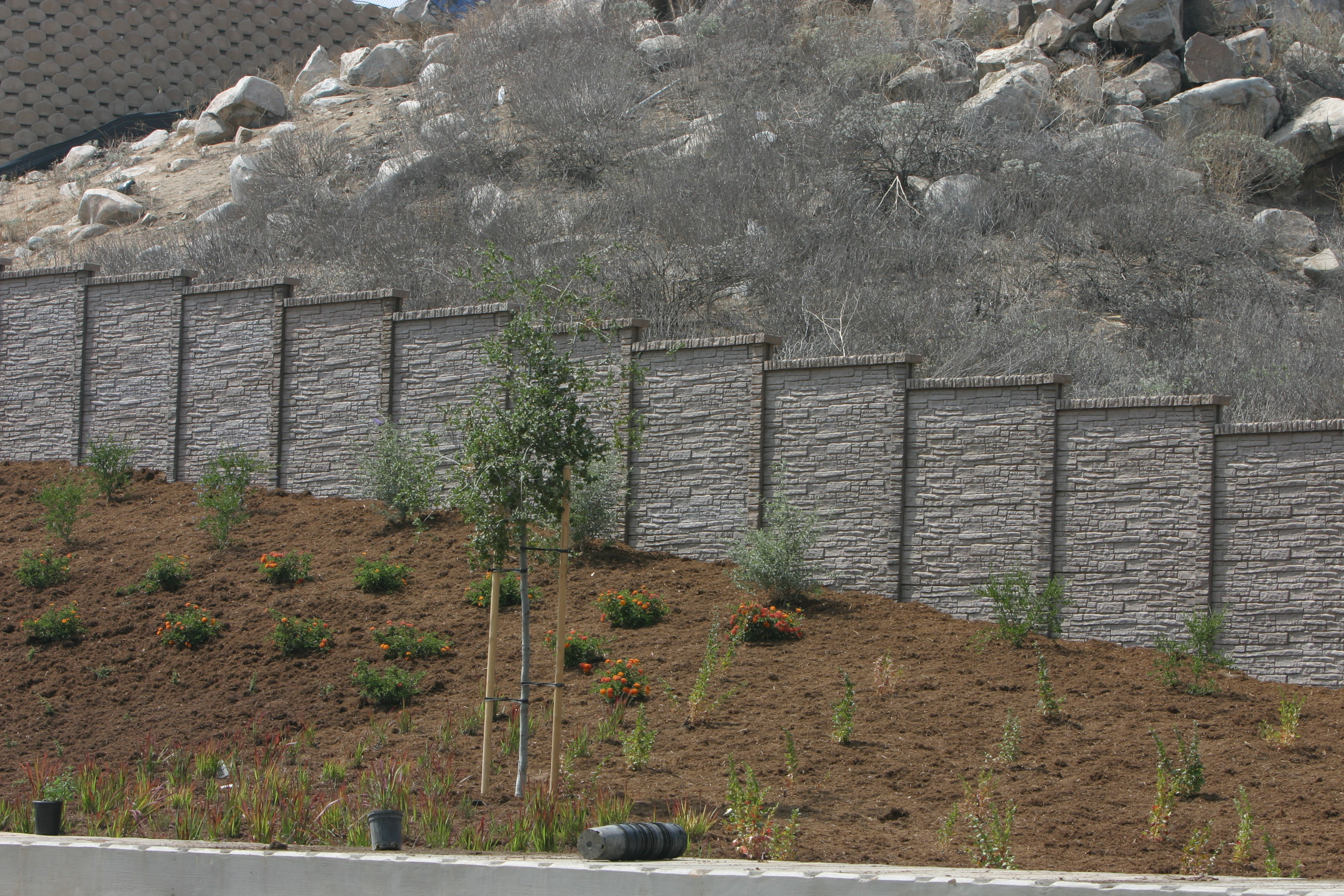 StackedStone precast fence wall